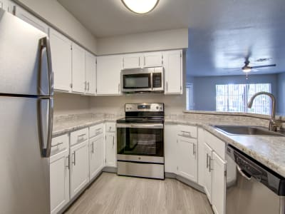 Modern kitchen with stainless-steel appliances at The Boulevard in Phoenix, Arizona