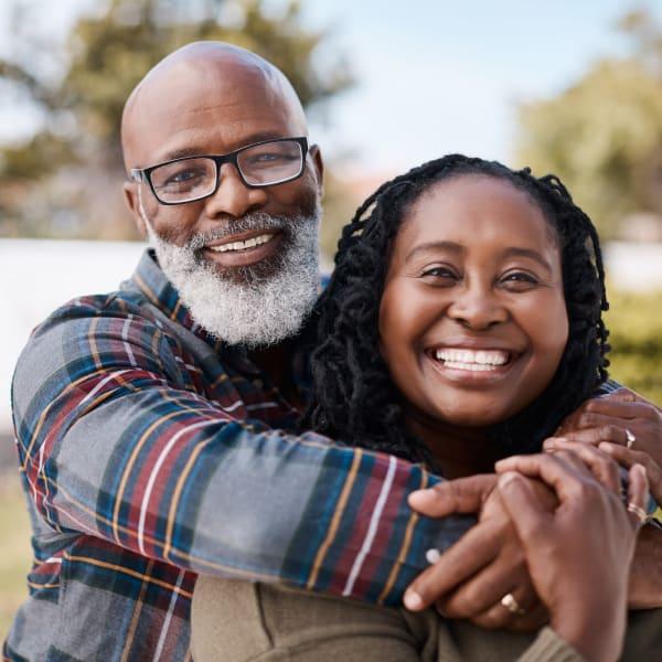 A resident couple emracing at The Atrium at Carmichael in Carmichael, California.