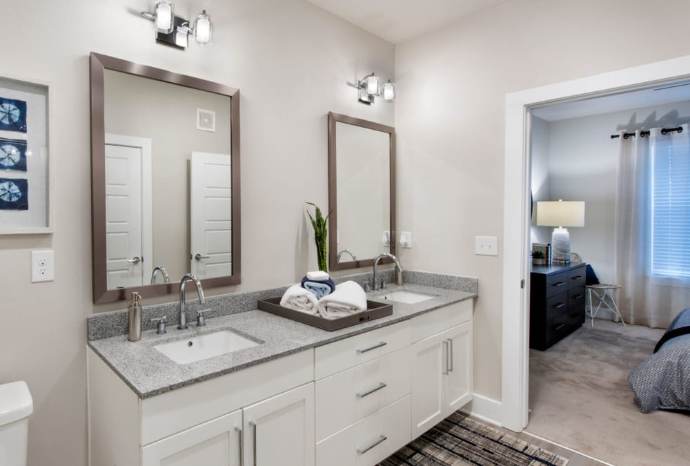 Two granite countertop sinks in bathroom of model home at The Elysian in St Johns, Florida