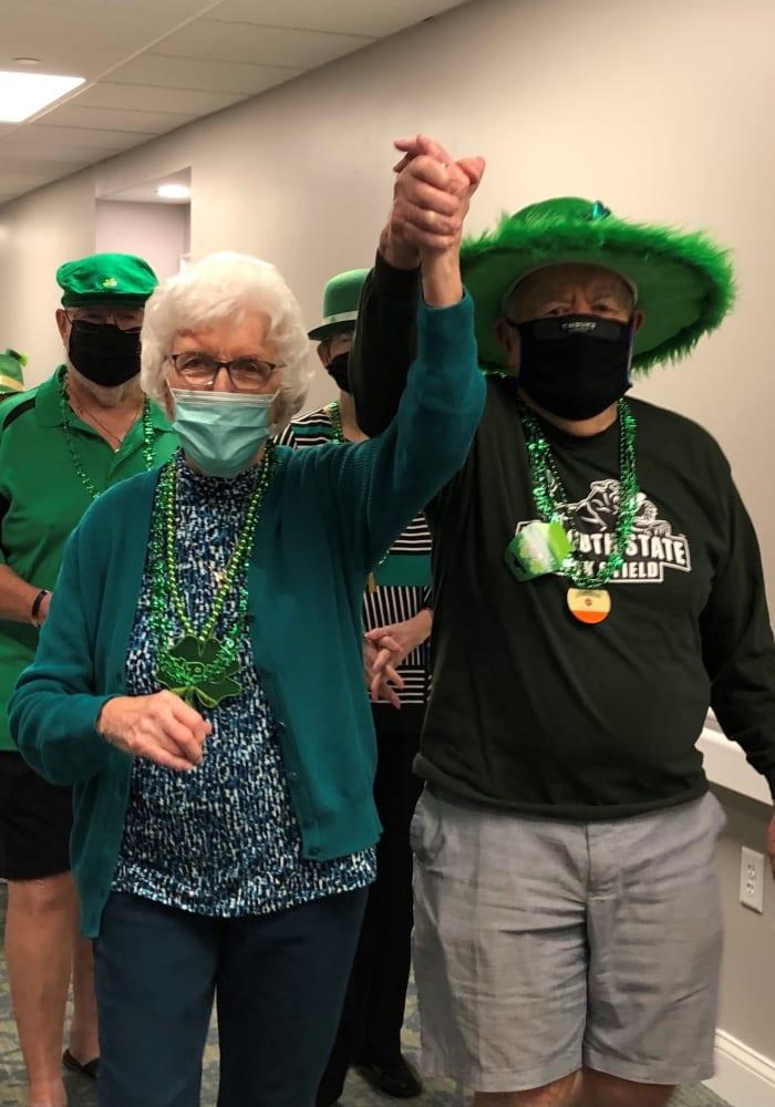 two senior residents enjoying a celebration