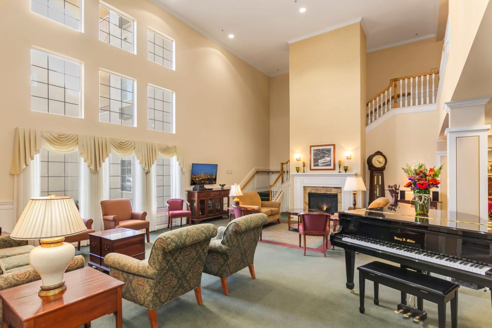 Beautiful living room with piano at our senior living community