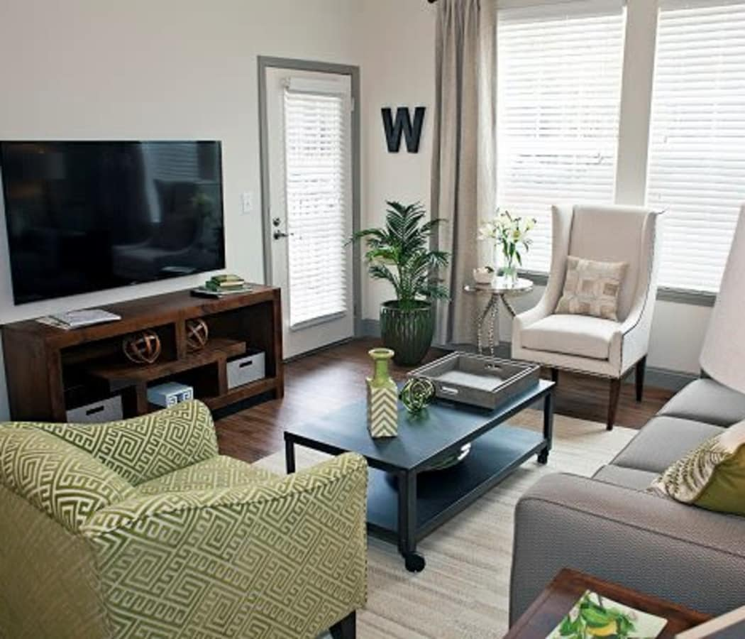Watercourse Apartments offers a natrually well-lit living room in Graham, North Carolina