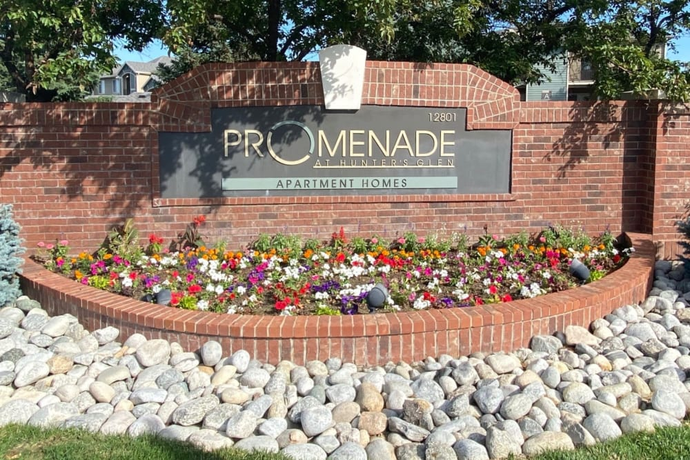 The front monument sign at Promenade at Hunter's Glen Apartments in Thornton, Colorado