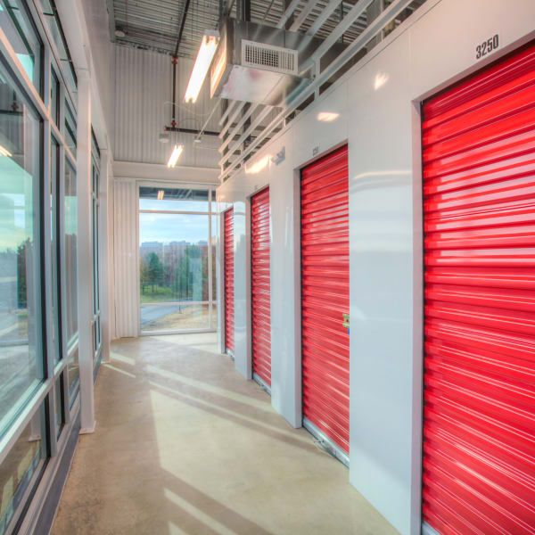 Interior units with red doors at StorQuest Self Storage in Greenwood Village, Colorado