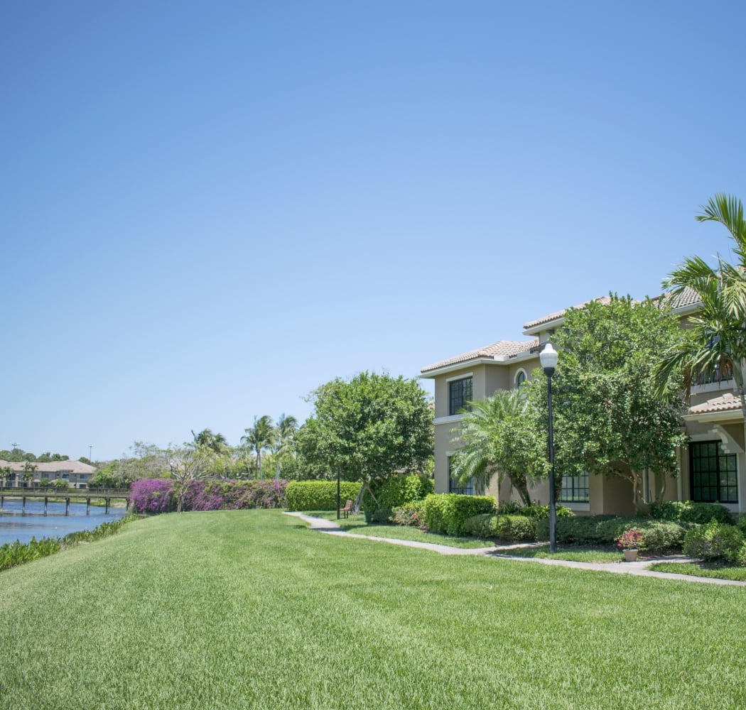 cosy homes for rent palm beach gardens. View of well maintained green spaces at San Merano Mirasol in Palm Beach  Gardens Apartments FL