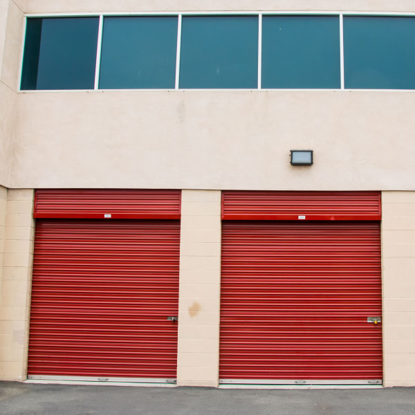 Outdoor storage units with red doors at StorQuest Self Storage in Long Beach, California
