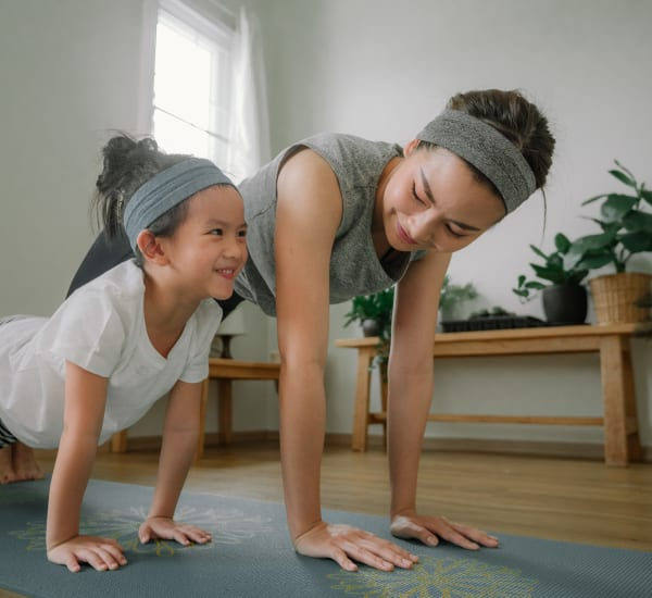 Mother and daughter doing yoga at Clocktower Mill and Velvet Mill Apartments in Manchester, Connecticut