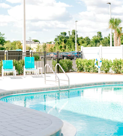 Outdoor poolside seating at Keystone Place at Four Mile Cove in Cape Coral, Florida