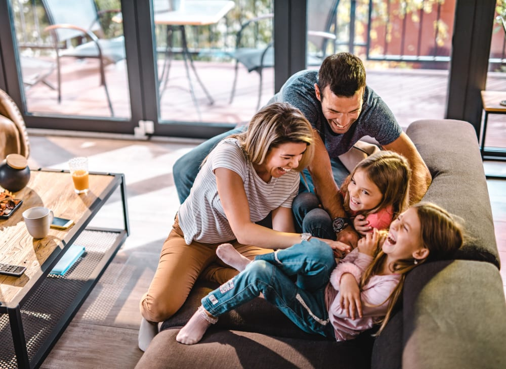 A family in their new apartment at The Columbia at the Waterfront in Vancouver, Washington