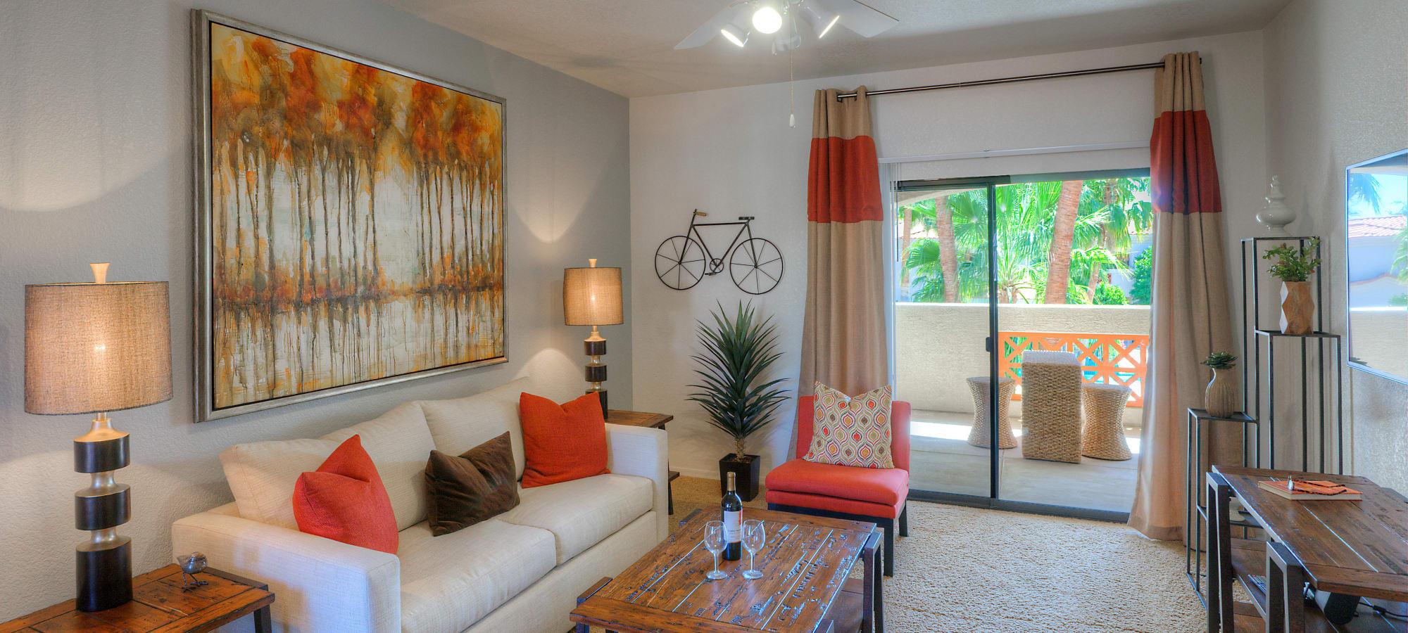 Model living room featuring sliding glass door at San Prado in Glendale, Arizona