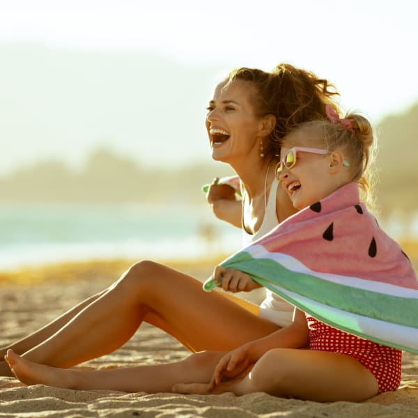 Resident mother and daughter enjoying some beach time near Town Lantana in Lantana, Florida