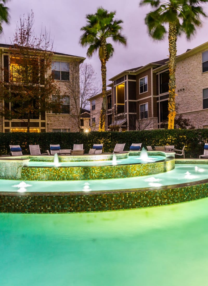 Water feature in pool at Marquis at The Woodlands in Spring, Texas