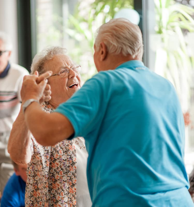 Senior couple dancing at Royalton Place