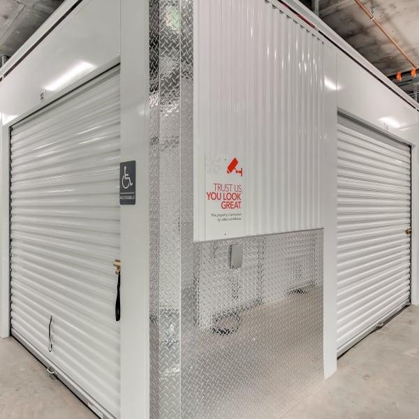 Indoor storage units with sign for digital surveillance at StorQuest Self Storage in Hawthorne, California