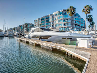 Boats in slips at the marina at our luxury waterfront community at Esprit Marina del Rey in Marina Del Rey, California