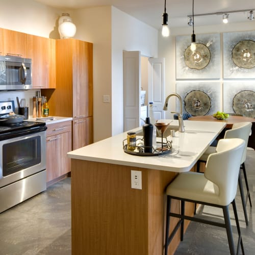 Well-equipped kitchen with island in a model home at Olympus Alameda in Albuquerque, New Mexico