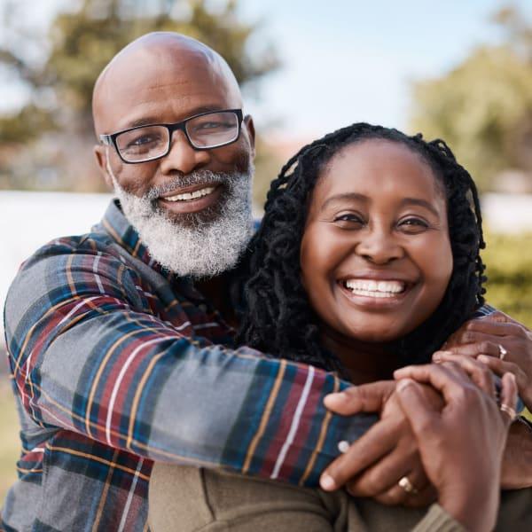 Couple embracing at Kenmore Senior Living in Kenmore, Washington