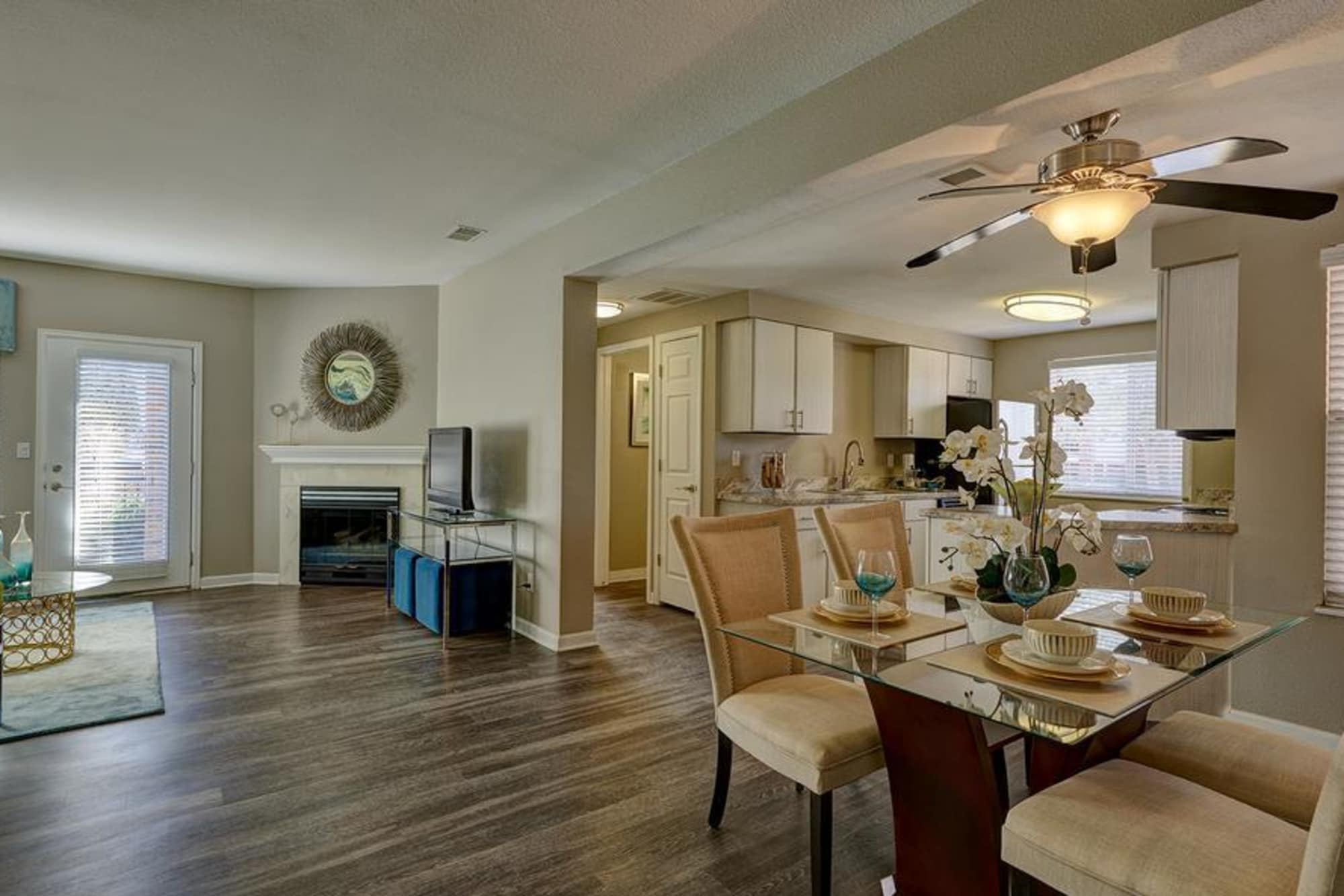 Lounge and Fully Equipped Kitchen and living room with fireplace at Villas at Homestead Apartments