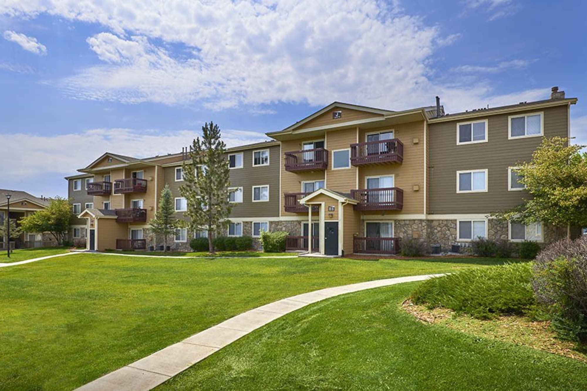 The exterior of Crossroads at City Center Apartments in Aurora, Colorado