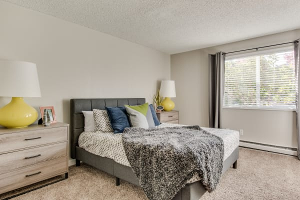 Well-lit bedroom at Copperstone Apartment Homes in Everett, WA