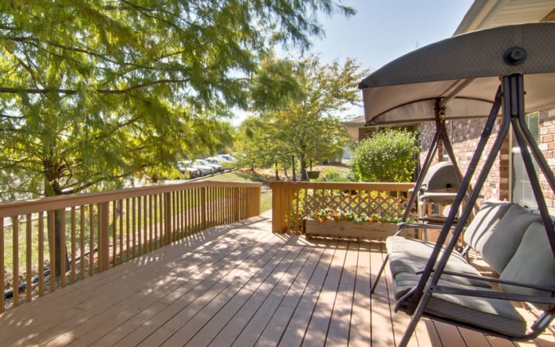 Outdoor patio with swing at Bluff Creek Terrace Senior Living in Columbia, Missouri
