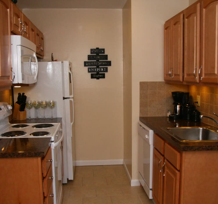 Fully-equipped kitchen at Ocean Harbor Apartments in Belmar, New Jersey
