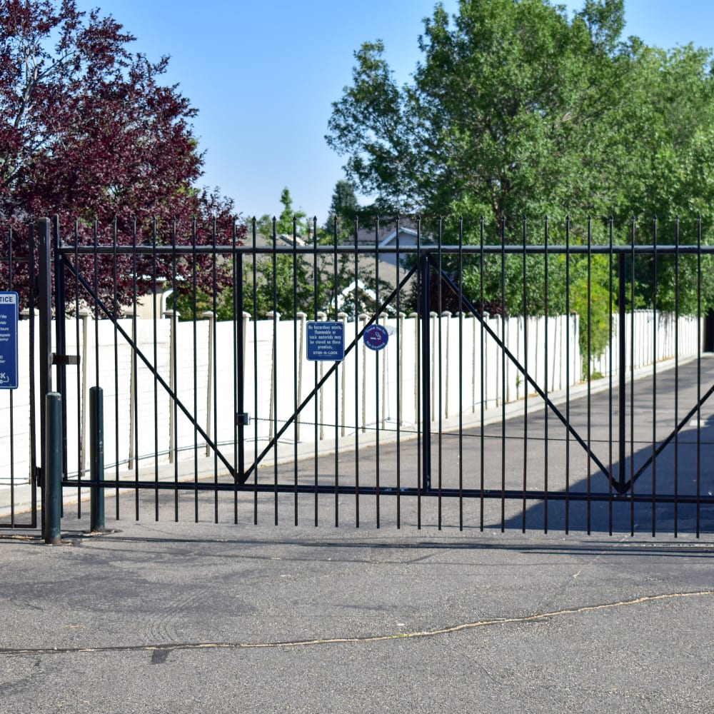 The secure front gate at STOR-N-LOCK Self Storage in Cottonwood Heights, Utah