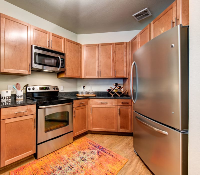 Modern kitchen with stainless steel appliances at The Marq on West 7th in Fort Worth, Texas
