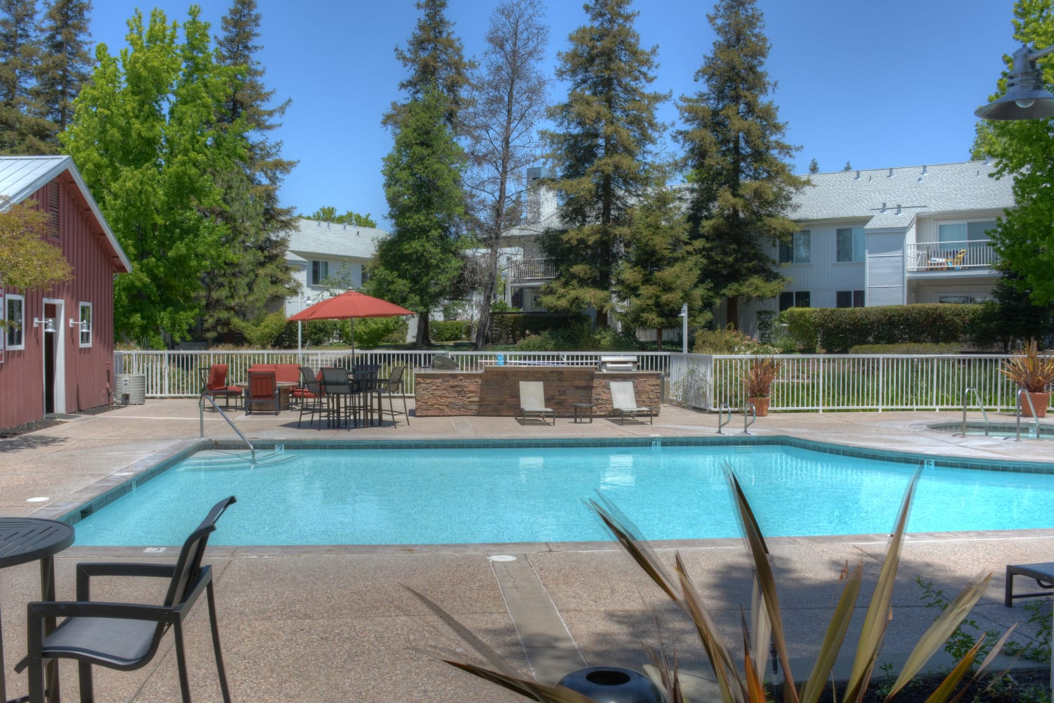 Enjoy access to a sparkling swimming pool at Cotton Wood Apartments in Dublin, California