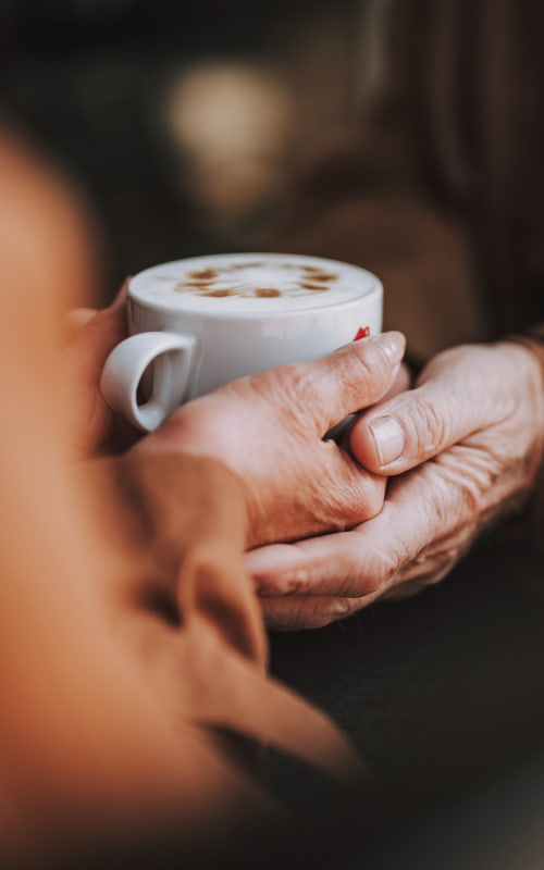 Resident drinking a latte at Jaybird Senior Living