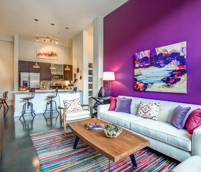 Luxury purple living room at Mercury NoDa in Charlotte, North Carolina