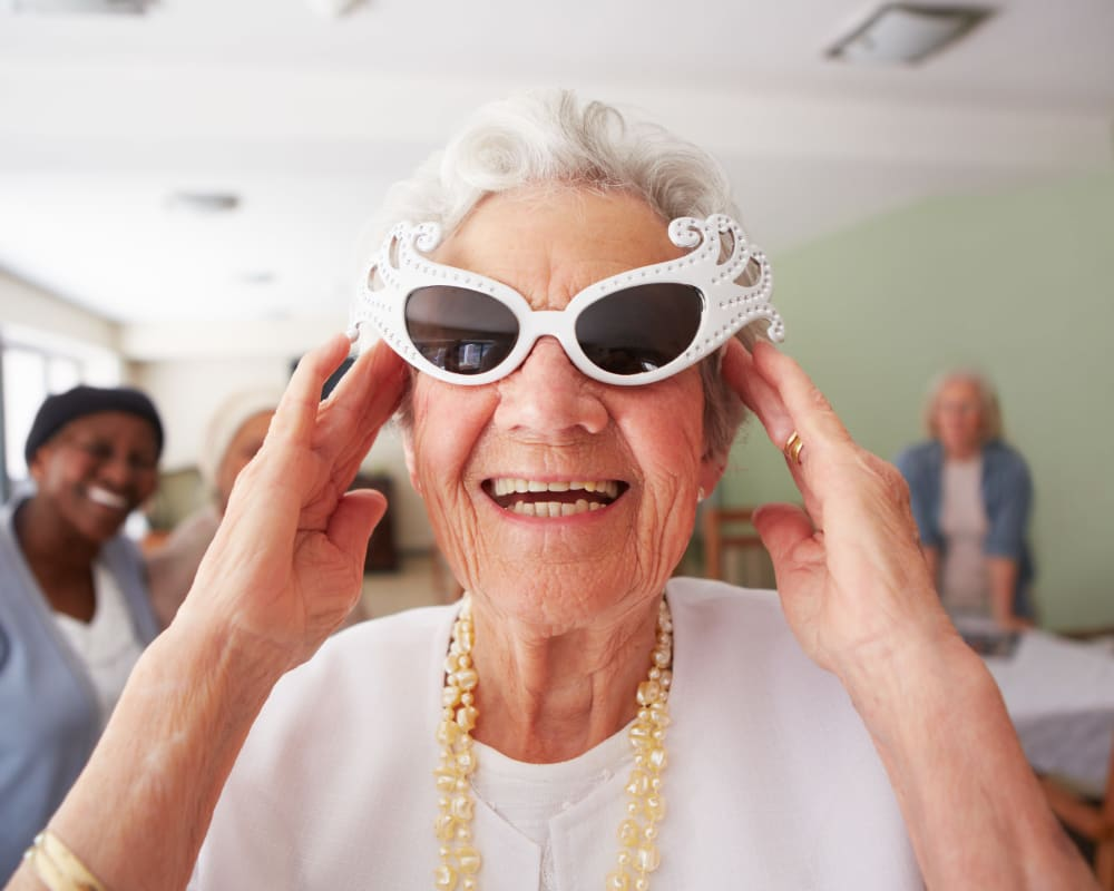 Resident wears fun sunglasses at Arlington Place of Grundy Center in Grundy Center, Iowa.