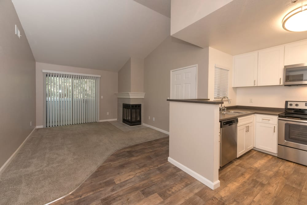 Kitchen and living room space at Park Ridge Apartment Homes in Rohnert Park, California