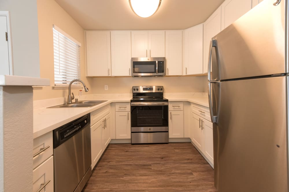 State-of-the-art kitchen with white cabinetry at Park Ridge Apartment Homes in Rohnert Park, California