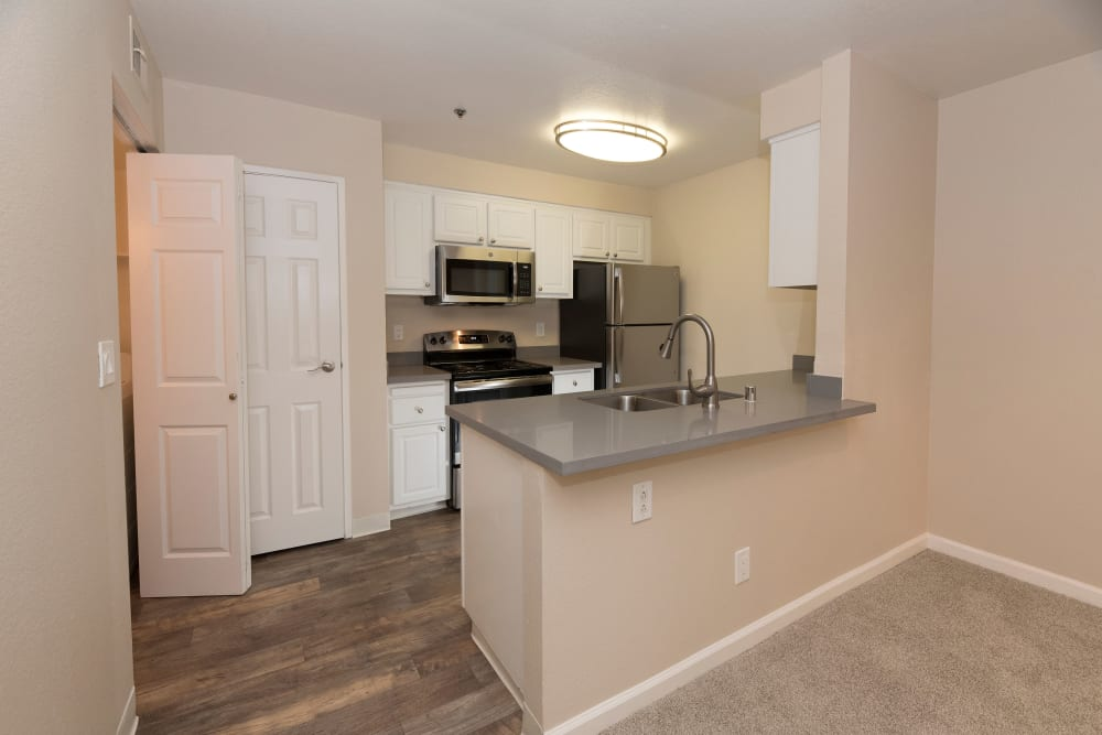 Spacious dining and living room at Sterling Heights Apartment Homes in Benicia, California