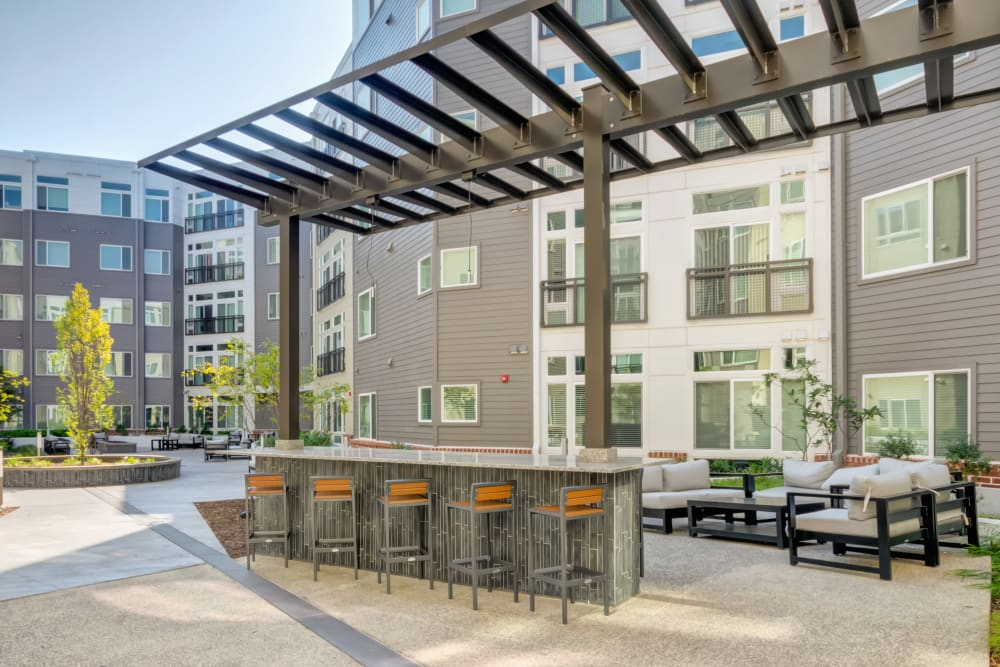 Modern outdoor bar, seating are at Crossings at Olde Towne