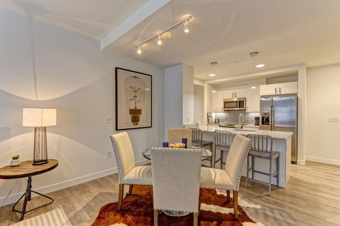 Spacious dining room with wood-style flooring at Vela on the Park in Stamford, CT