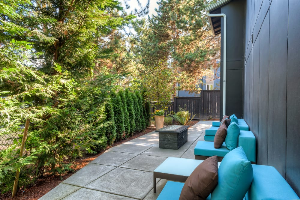 Fire pit lounge area at Karbon Apartments in Newcastle, Washington