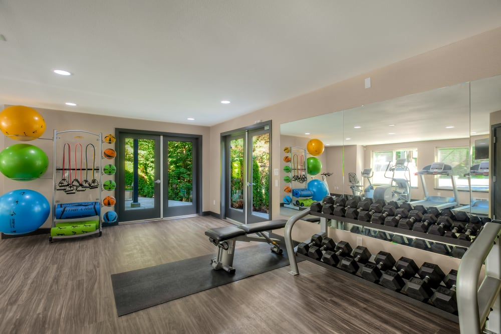 Clean, modern community gym at Karbon Apartments in Newcastle, Washington