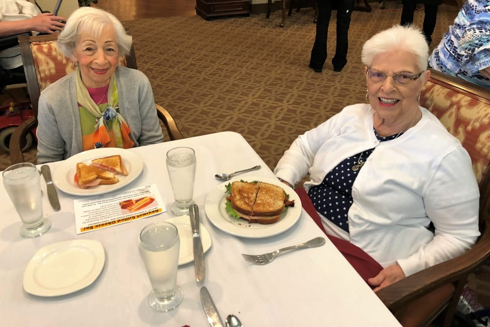 Residents enjoying a meal at Merrill Gardens at Solivita Marketplace in Kissimmee, Florida.