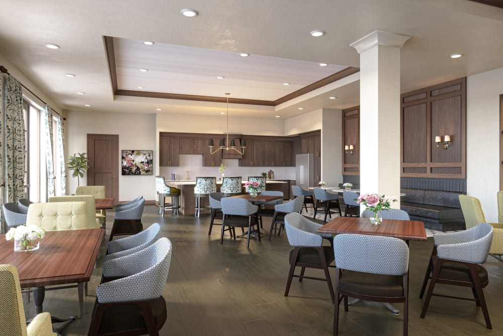 Community dining room with several spaced out tables at Amira Minnetonka in Minnetonka, Minnesota