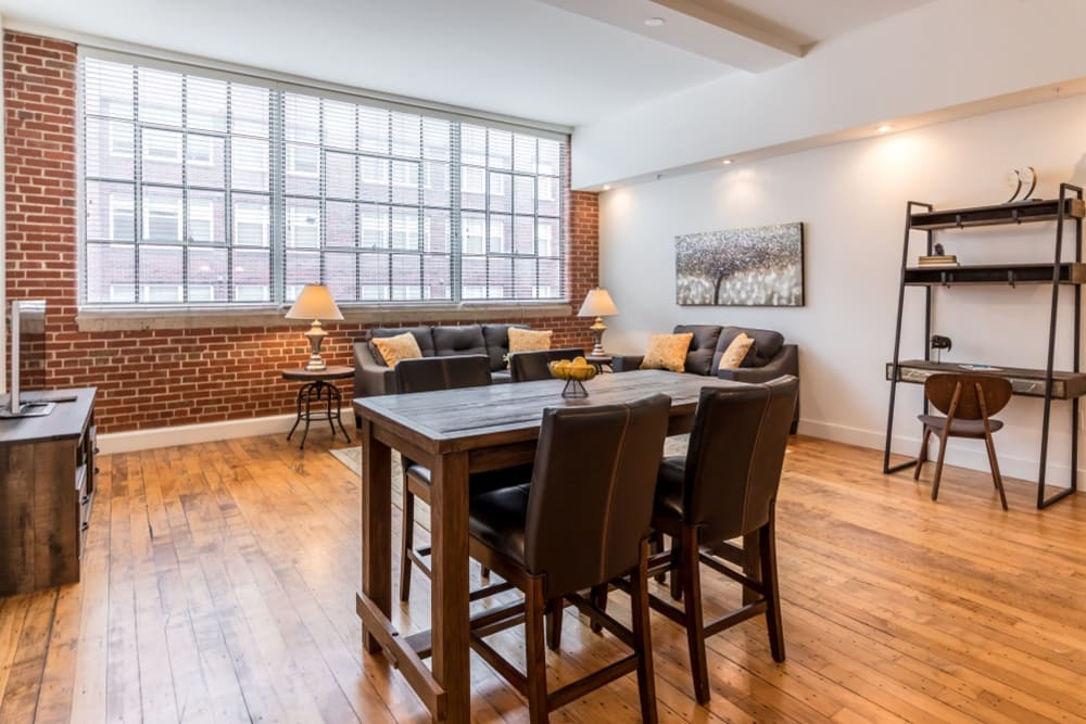 Model dining area with large windows at The Gallery Lofts in Winston Salem, North Carolina