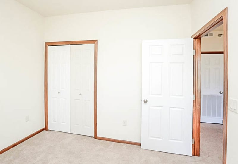 Bedroom with carpet at Johnston Heights in Johnston, Iowa
