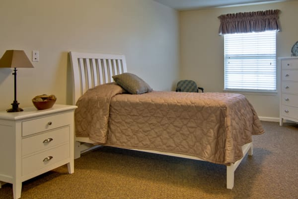 Assisted living apartment bedroom at Sugar Creek Senior Living in Troy, Missouri