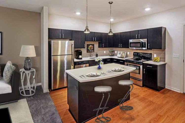 Kitchen with breakfast bar at Eden Square Apartments in Cranberry Township, PA