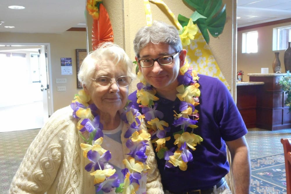 A resident couple at a luau party at Merrill Gardens at Gilroy in Gilroy, California.