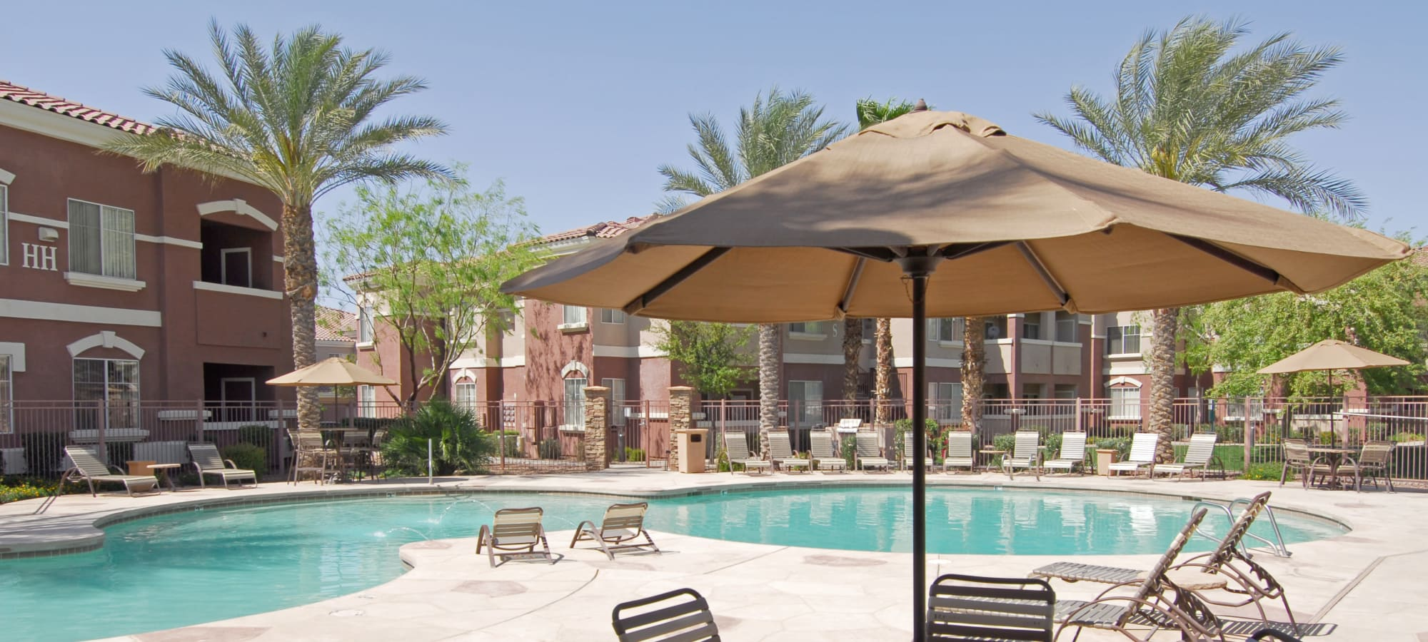 Swimming pool with shaded seating at Remington Ranch in Litchfield Park, Arizona