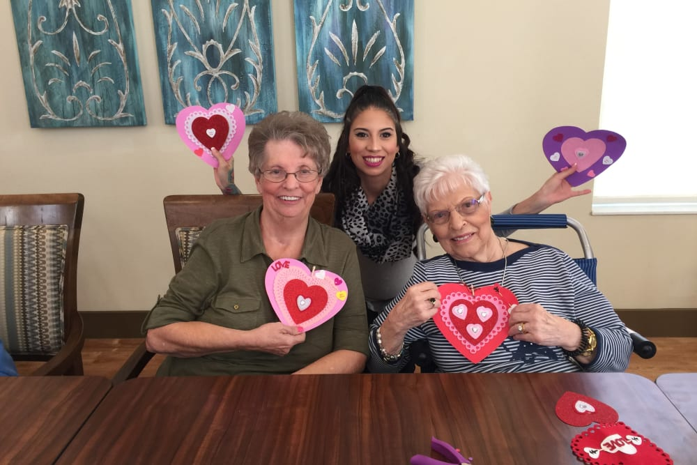 Senior residents enjoying Valentines day crafts at Merrill Gardens at Solivita Marketplace in Kissimmee, Florida.