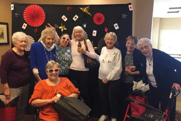 Residents enjoying a party at The Oaks, A Merrill Gardens Community in Gilbert, Arizona.