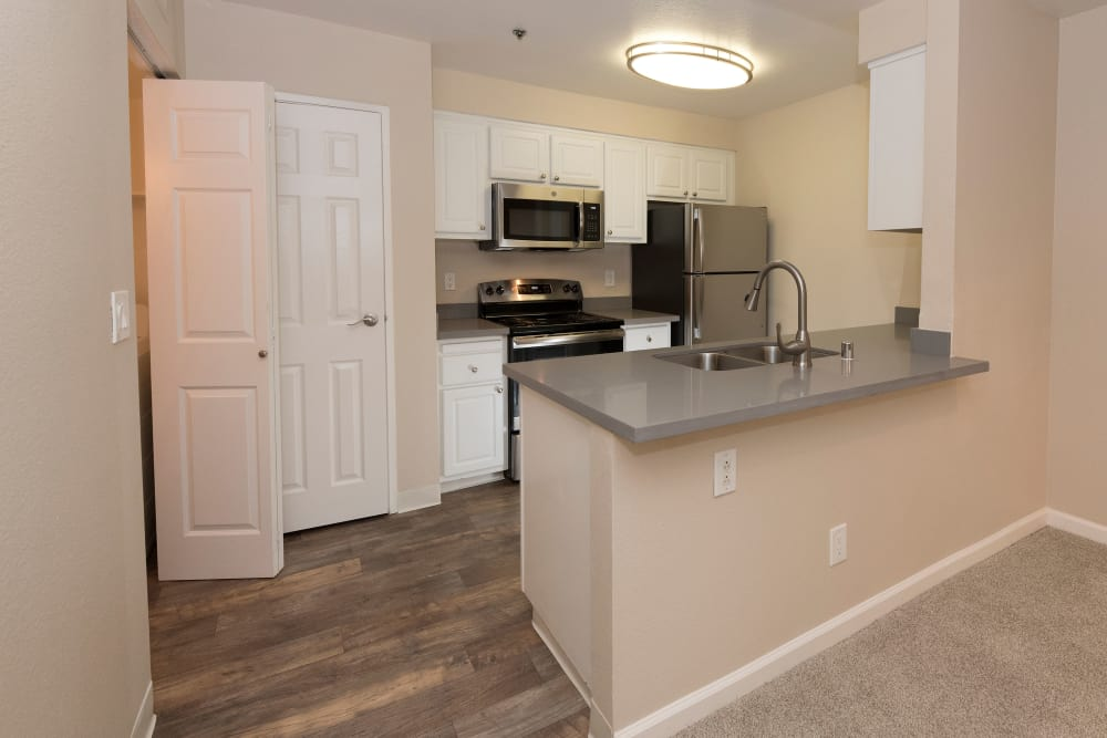 Model kitchen with white cabinetry at Sterling Heights Apartment Homes in Benicia, California
